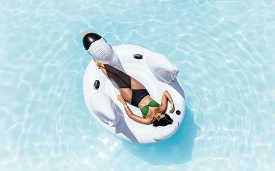 Woman In Pool On Swan Floatie