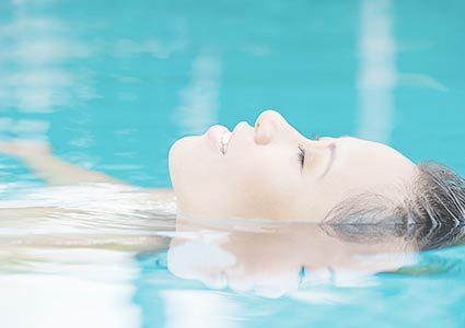 Woman With Eyes Closed In Pool