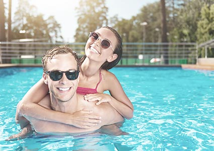 Happy Couple Inside Their Pool