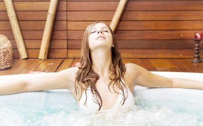 Brunette Woman Relaxing In Hot Tub